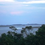 The Cape Lookout Lighthouse stands on the horizon, like a guardian of the National Seashore