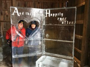 Writer and photographer pose in ice sweetheart frame.