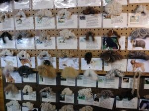 Educational board identifying and samples of dog hair for knitting?