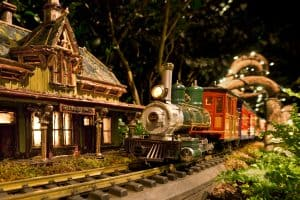 G-scale train riding past New York botanical garden's replica of the old Bedford Station in the Bronx