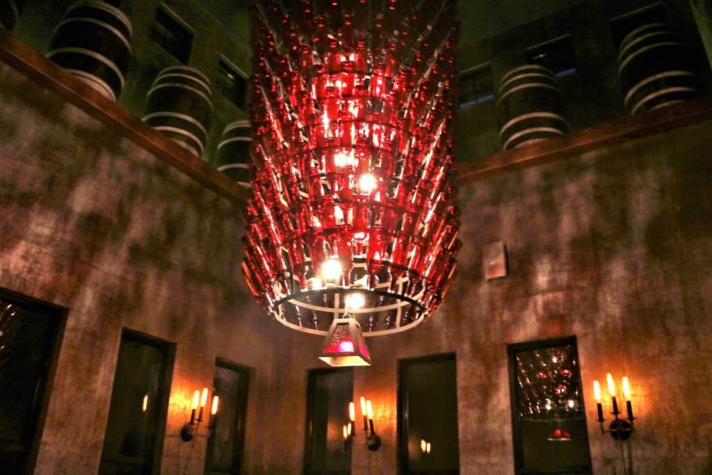 Wine bottle chandelier in the Crush House.
